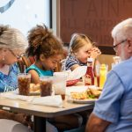 Grandparents and their grandchildren dining in Huddle House