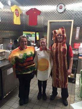 Huddle House Employees Dressed Up As A Burger, Eggs, And Bacon