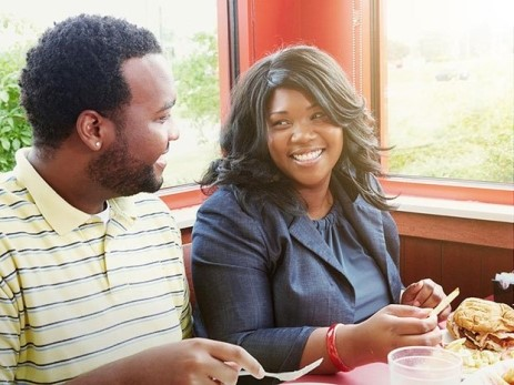 a couple eating at Huddle House